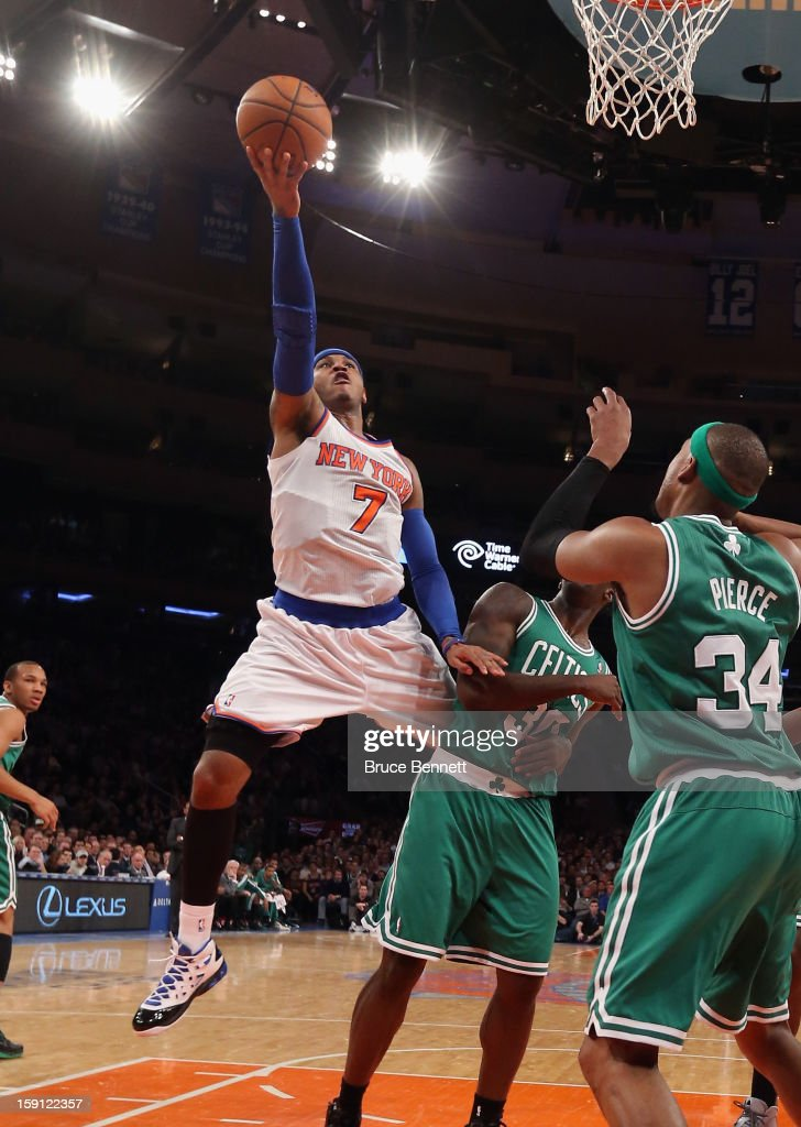 Carmelo Anthony #7 of the New York Knicks looks to score two against the Boston Celtics at Madison Square Garden on January 7, 2013 in New York City.