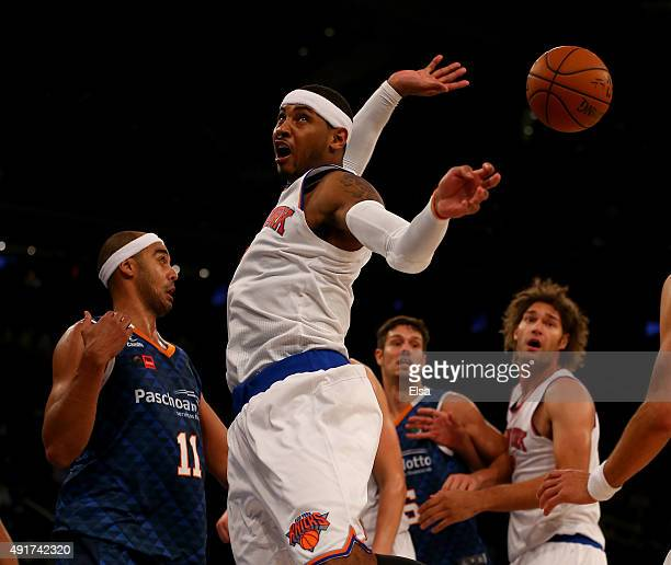 Carmelo Anthony of the New York Knicks loses the ball as Jefferson William of Paschoalotto Bauru defends in the second half of the preseason...
