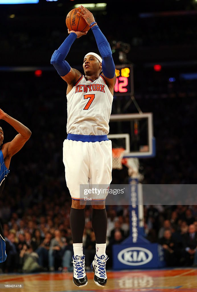 <a gi-track='captionPersonalityLinkClicked' href=/galleries/search?phrase=Carmelo+Anthony&family=editorial&specificpeople=201494 ng-click='$event.stopPropagation()'>Carmelo Anthony</a> #7 of the New York Knicks makes a three point shot to give him his 30th game with twenty or more points during the second half against the Orlando Magic on January 30, 2013 at Madison Square Garden in New York City. The New York Knicks defeated the Orlando Magic 113-97.
