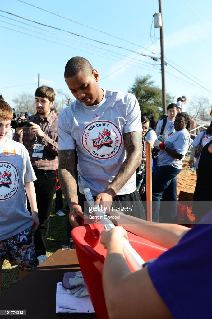 Carmelo Anthony #7 of the New York Knicks participates at the 2013 NBA Cares Day of Service at the Playground Build with KaBOOM! on February 15, 2013 in Houston, Texas.