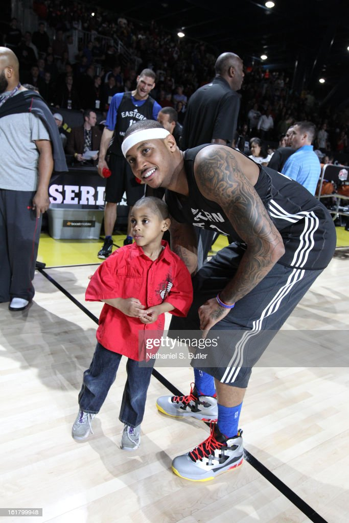 Carmelo Anthony #7 of the New York Knicks poses with a young kid during the NBA All-Star Practice in Sprint Arena at Jam Session at Jam Session during NBA All Star Weekend on February 16, 2013 at the George R. Brown in Houston, Texas.