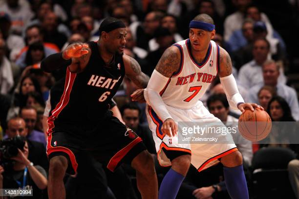 Carmelo Anthony of the New York Knicks posts up against LeBron James of the Miami Heat in Game Three of the Eastern Conference Quarterfinals in the...