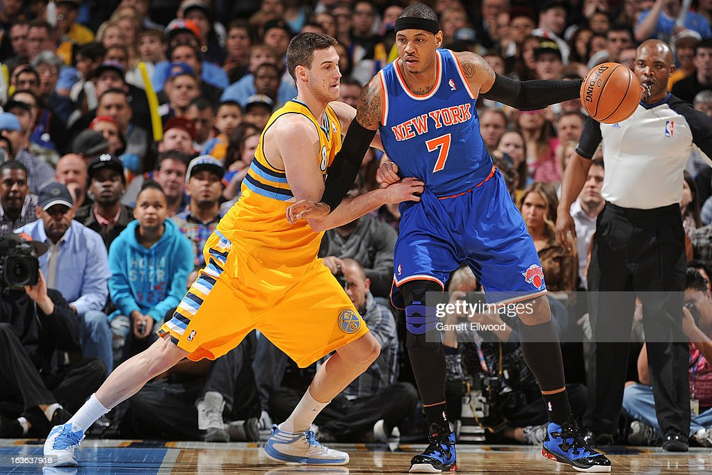 Carmelo Anthony #7 of the New York Knicks posts-up against Danilo Gallinari #8 of the Denver Nuggets on March 13, 2013 at the Pepsi Center in Denver, Colorado.
