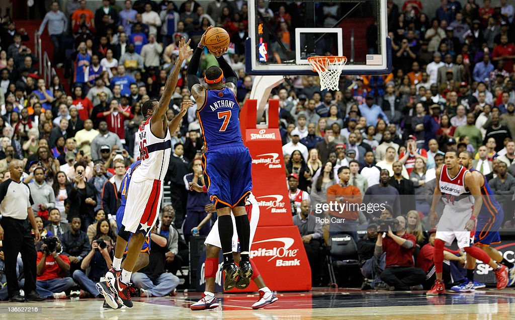 <a gi-track='captionPersonalityLinkClicked' href=/galleries/search?phrase=Carmelo+Anthony&family=editorial&specificpeople=201494 ng-click='$event.stopPropagation()'>Carmelo Anthony</a> #7 of the New York Knicks puts up a shot against the defense of Trevor Booker #35 of the Washington Wizards late in the second half at Verizon Center on January 6, 2012 in Washington, DC.