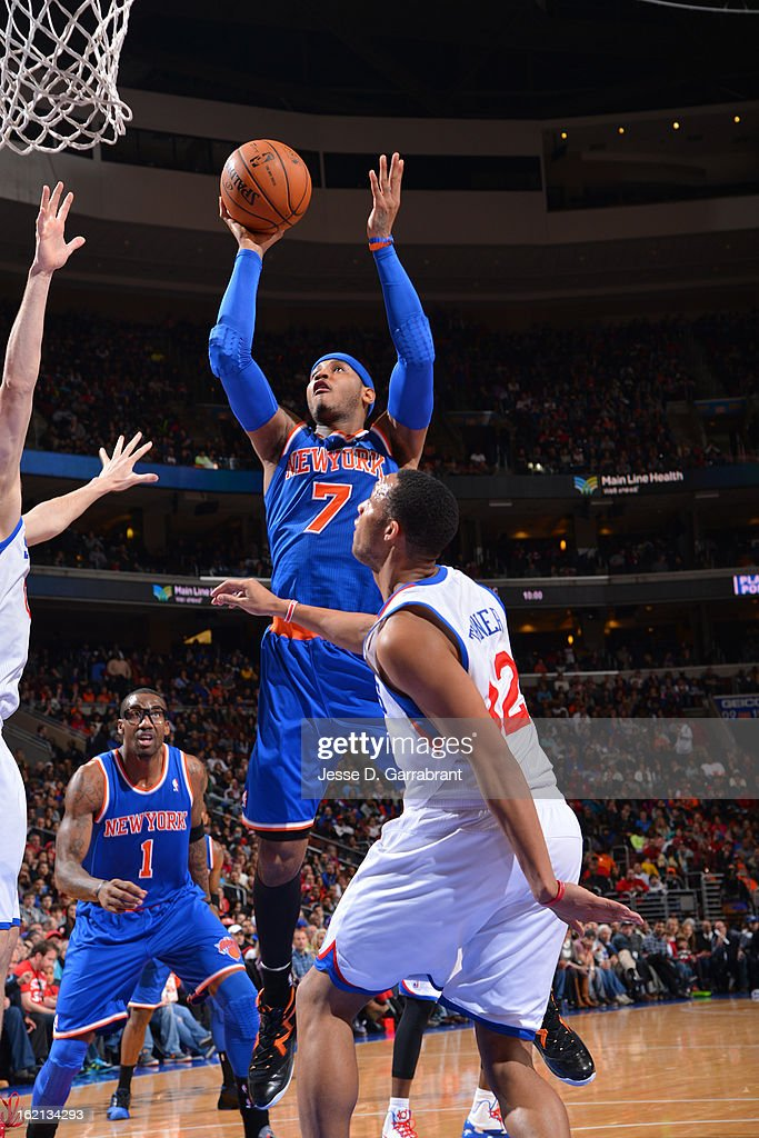 <a gi-track='captionPersonalityLinkClicked' href=/galleries/search?phrase=Carmelo+Anthony&family=editorial&specificpeople=201494 ng-click='$event.stopPropagation()'>Carmelo Anthony</a> #7 of the New York Knicks puts up a shot against the Philadelphia 76ers at the Wells Fargo Center on January 26, 2013 in Philadelphia, Pennsylvania.