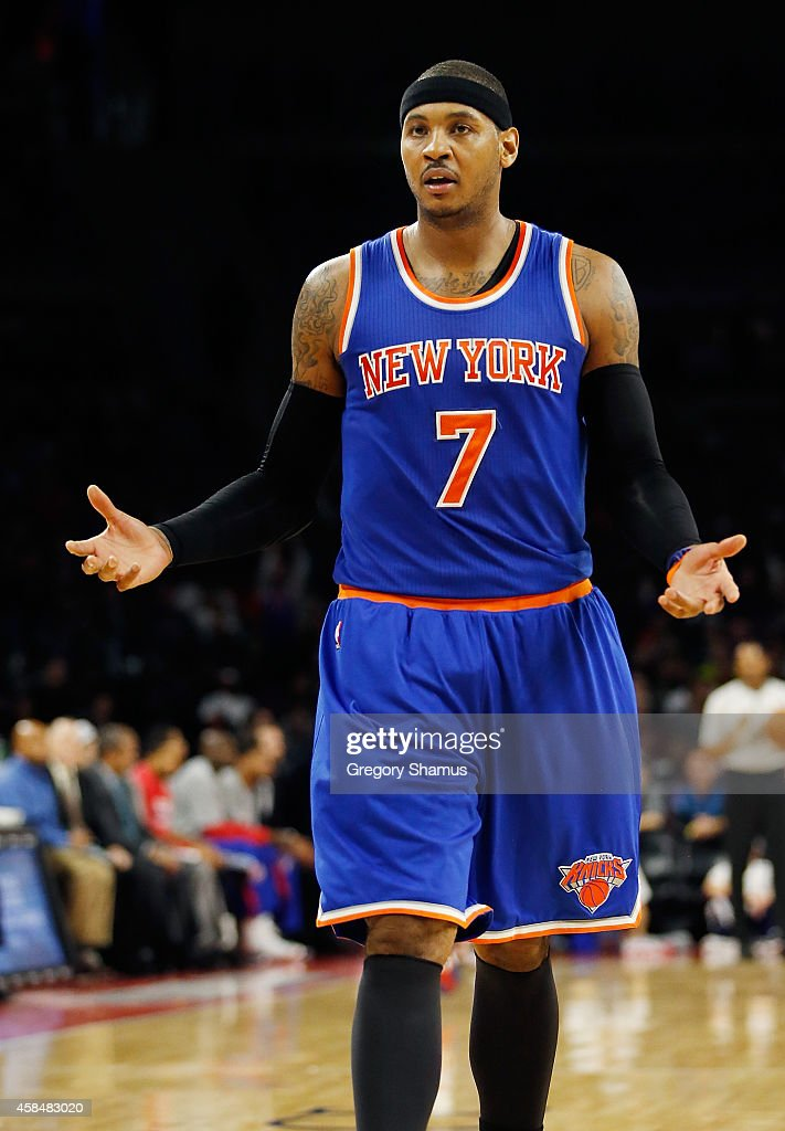 <a gi-track='captionPersonalityLinkClicked' href=/galleries/search?phrase=Carmelo+Anthony&family=editorial&specificpeople=201494 ng-click='$event.stopPropagation()'>Carmelo Anthony</a> #7 of the New York Knicks reacts after a first half turnover while playing the Detroit Pistons at the Palace of Auburn Hills on November 5, 2014 in Auburn Hills, Michigan.