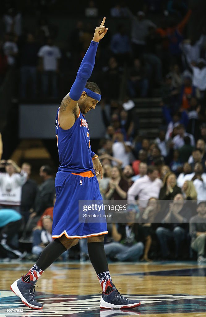 Carmelo Anthony #7 of the New York Knicks reacts after a shot at the end of the game by teammate Kristaps Porzingis #6 of the New York Knicks that was overturned giving the Hornets a 95-93 victory at Time Warner Cable Arena on November 11, 2015 in Charlotte, North Carolina.