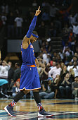 Carmelo Anthony of the New York Knicks reacts after a shot at the end of the game by teammate Kristaps Porzingis of the New York Knicks that was...
