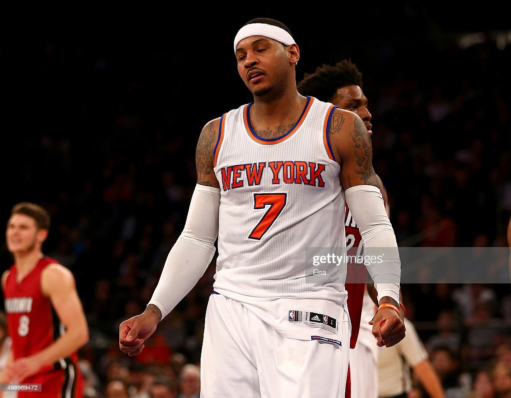 <a gi-track='captionPersonalityLinkClicked' href=/galleries/search?phrase=Carmelo+Anthony&family=editorial&specificpeople=201494 ng-click='$event.stopPropagation()'>Carmelo Anthony</a> #7 of the New York Knicks reacts after he is called for a foul in the second half against the Miami Heat at Madison Square Garden on November 27, 2015 in New York City.NOTE