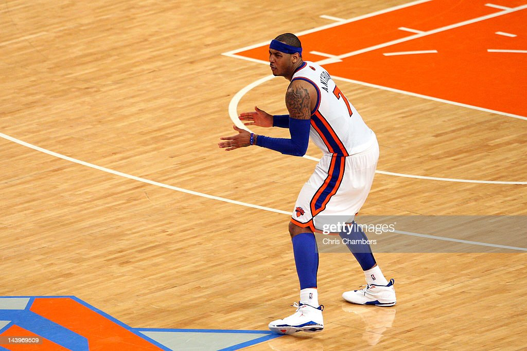 Carmelo Anthony #7 of the New York Knicks reacts after he made a 3-point shot to put thew Knicks up 87-84 in the fourth quarter in Game Four of the Eastern Conference Quarterfinals in the 2012 NBA Playoffs on May 6, 2012 at Madison Square Garden in New York City.