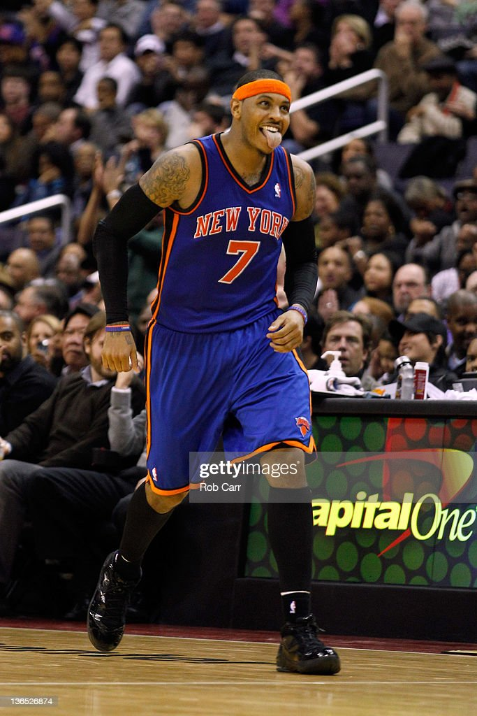 <a gi-track='captionPersonalityLinkClicked' href=/galleries/search?phrase=Carmelo+Anthony&family=editorial&specificpeople=201494 ng-click='$event.stopPropagation()'>Carmelo Anthony</a> #7 of the New York Knicks reacts after making a basket during the second half against the Washington Wizards at Verizon Center on January 6, 2012 in Washington, DC.