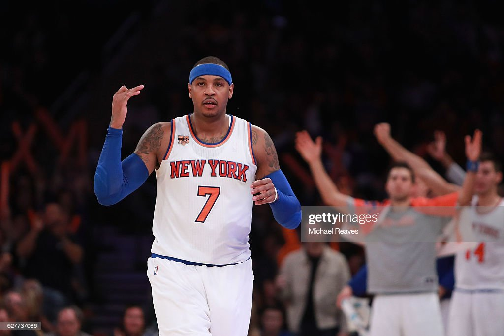 Carmelo Anthony #7 of the New York Knicks reacts after making a three pointer against the Sacramento Kings during the second half at Madison Square Garden on December 4, 2016 in New York City.