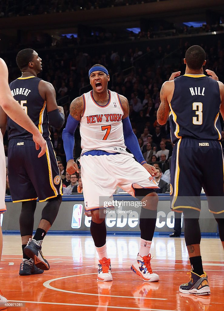 Carmelo Anthony #7 of the New York Knicks reacts after scoring a basket against the Indiana Pacers at Madison Square Garden on November 20, 2013 in New York City.