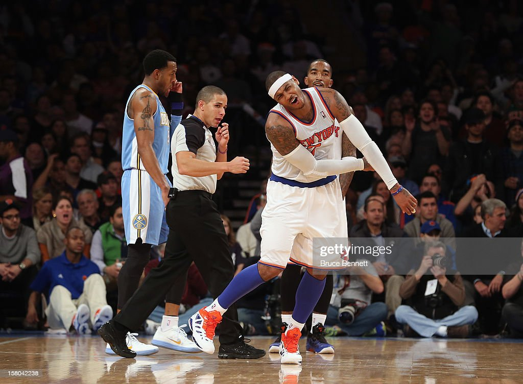 Carmelo Anthony #7 of the New York Knicks reacts after taking a foul against the Denver Nuggets and is givena technical foul at Madison Square Garden on December 9, 2012 in New York City.