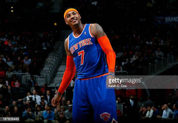 Carmelo Anthony of the New York Knicks reacts between free throws against the Atlanta Hawks at Philips Arena on November 13 2013 in Atlanta Georgia...
