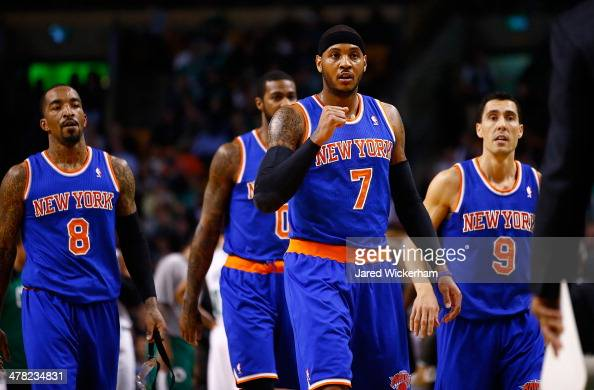 Carmelo Anthony of the New York Knicks reacts following a timeout in the first quarter against the Boston Celtics during the game at TD Garden on...