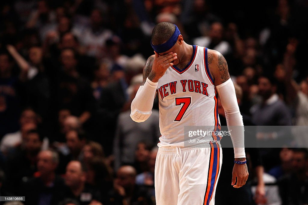 <a gi-track='captionPersonalityLinkClicked' href=/galleries/search?phrase=Carmelo+Anthony&family=editorial&specificpeople=201494 ng-click='$event.stopPropagation()'>Carmelo Anthony</a> #7 of the New York Knicks reacts in the fourth quarter against the Miami Heat in Game Three of the Eastern Conference Quarterfinals in the 2012 NBA Playoffs on May 3, 2012 at Madison Square Garden in New York City.
