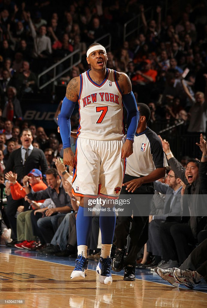 <a gi-track='captionPersonalityLinkClicked' href=/galleries/search?phrase=Carmelo+Anthony&family=editorial&specificpeople=201494 ng-click='$event.stopPropagation()'>Carmelo Anthony</a> #7 of the New York Knicks reacts to the game action against the Orlando Magic on March 28, 2012 at Madison Square Garden in New York City.