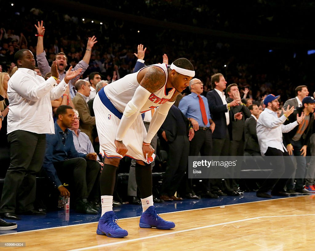 Carmelo Anthony #7 of the New York Knicks reacts to the loss as the Cleveland Cavaliers win at Madison Square Garden on December 4, 2014 in New York City.The Cleveland Cavaliers defeated the New York Knicks 90-87.NOTE