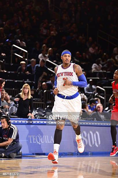 Carmelo Anthony of the New York Knicks runs up the court during a game against the Toronto Raptors at Madison Square Garden on October 13 2014 in New...