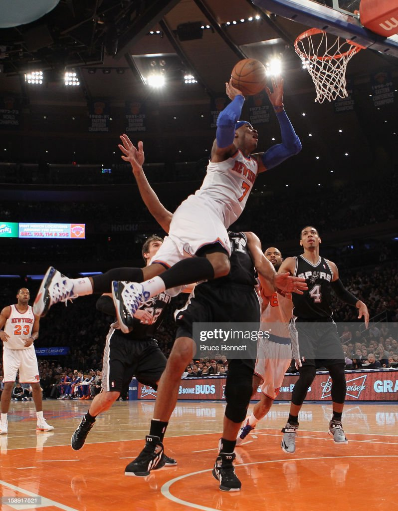 Carmelo Anthony #7 of the New York Knicks scores two in the second quarter against the San Antonio Spurs at Madison Square Garden on January 3, 2013 in New York City.