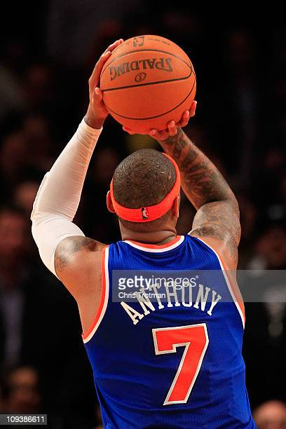 Carmelo Anthony of the New York Knicks shoots a free throw against the Milwaukee Bucks at Madison Square Garden on February 23 2011 in New York City...