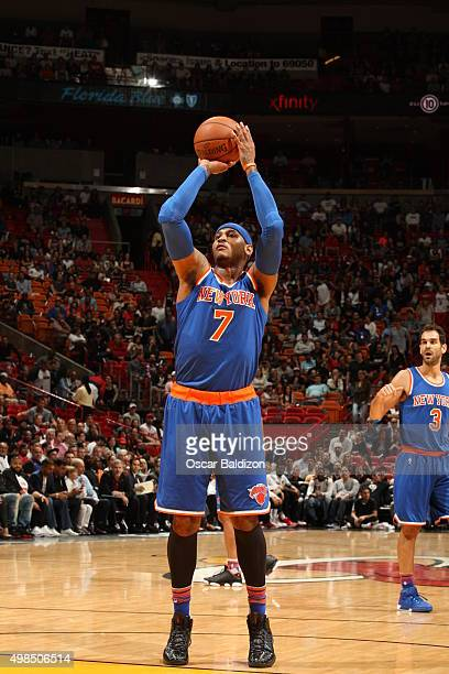 Carmelo Anthony of the New York Knicks shoots a free throw against the Miami Heat on November 23 2015 at American Airlines Arena in Miami Florida...
