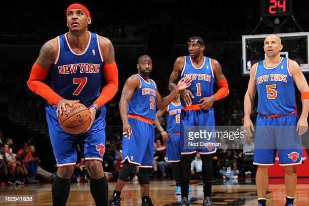 Carmelo Anthony of the New York Knicks shoots a free throw whilst teammates watch against the Washington Wizards during the game at the Verizon...