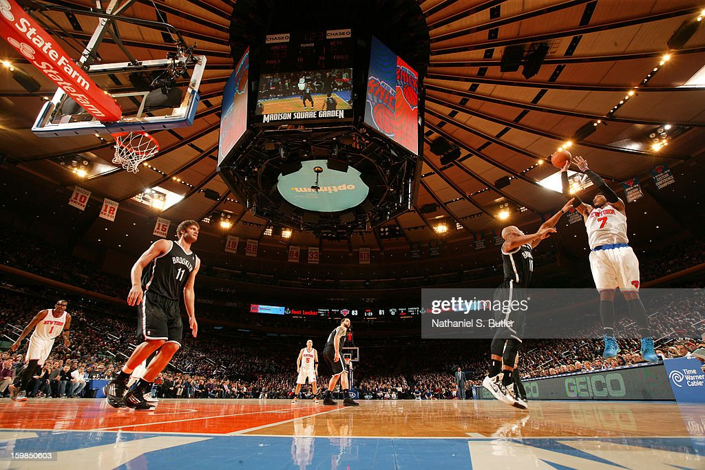 Carmelo Anthony #7 of the New York Knicks shoots a jumper against Keith Bogans #10 of the Brooklyn Nets on January 21, 2013 at Madison Square Garden in New York City.