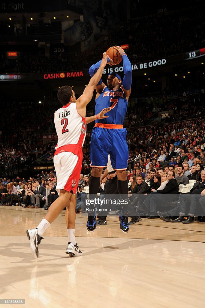 <a gi-track='captionPersonalityLinkClicked' href=/galleries/search?phrase=Carmelo+Anthony&family=editorial&specificpeople=201494 ng-click='$event.stopPropagation()'>Carmelo Anthony</a> #7 of the New York Knicks shoots a jumper against <a gi-track='captionPersonalityLinkClicked' href=/galleries/search?phrase=Landry+Fields&family=editorial&specificpeople=4184645 ng-click='$event.stopPropagation()'>Landry Fields</a> #2 of the Toronto Raptors on February 22, 2013 at the Air Canada Centre in Toronto, Ontario, Canada.