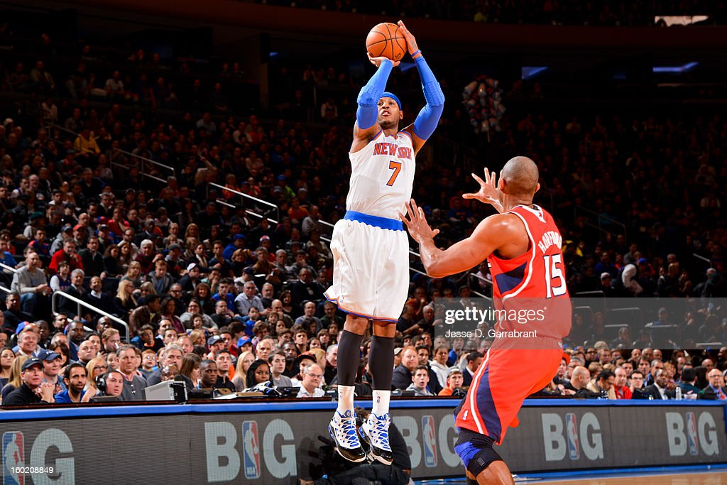 Carmelo Anthony #7 of the New York Knicks shoots a three-pointer against Al Horford #15 of the Atlanta Hawks at Madison Square Garden on January 27, 2013 in New York, New York.
