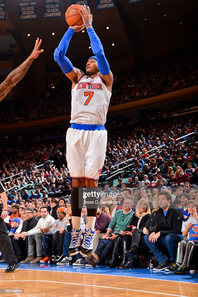 Carmelo Anthony #7 of the New York Knicks shoots a three-pointer against the Atlanta Hawks at Madison Square Garden on January 27, 2013 in New York, New York.