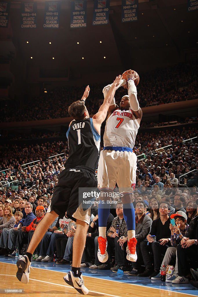Carmelo Anthony #7 of the New York Knicks shoots against Alexey Shved #1 of the Minnesota Timberwolves on December 23, 2012 at Madison Square Garden in New York City.