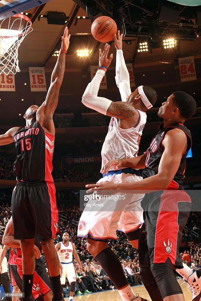 <a gi-track='captionPersonalityLinkClicked' href=/galleries/search?phrase=Carmelo+Anthony&family=editorial&specificpeople=201494 ng-click='$event.stopPropagation()'>Carmelo Anthony</a> #7 of the New York Knicks shoots against <a gi-track='captionPersonalityLinkClicked' href=/galleries/search?phrase=Amir+Johnson&family=editorial&specificpeople=556786 ng-click='$event.stopPropagation()'>Amir Johnson</a> #15 of the Toronto Raptors on February 13, 2013 at Madison Square Garden in New York City.