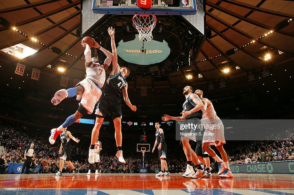 <a gi-track='captionPersonalityLinkClicked' href=/galleries/search?phrase=Carmelo+Anthony&family=editorial&specificpeople=201494 ng-click='$event.stopPropagation()'>Carmelo Anthony</a> #7 of the New York Knicks shoots against Andre Kirilenko #47 of the Minnesota Timberwolves on December 23, 2012 at Madison Square Garden in New York City.