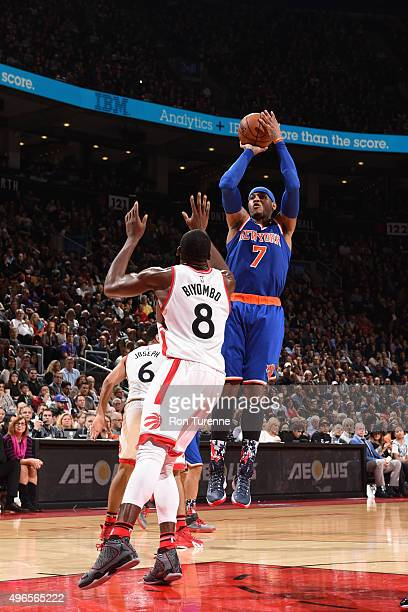 Carmelo Anthony of the New York Knicks shoots against Bismack Biyombo of the Toronto Raptors during the game on November 10 2015 at Air Canada Centre...