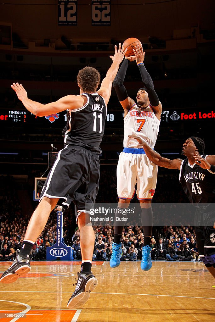 Carmelo Anthony #7 of the New York Knicks shoots against Brook Lopez #11 and Gerald Wallace #45 of the Brooklyn Nets on January 21, 2013 at Madison Square Garden in New York City.
