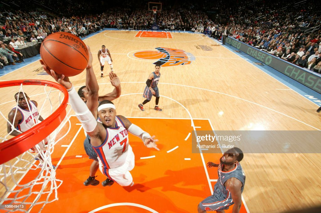 <a gi-track='captionPersonalityLinkClicked' href=/galleries/search?phrase=Carmelo+Anthony&family=editorial&specificpeople=201494 ng-click='$event.stopPropagation()'>Carmelo Anthony</a> #7 of the New York Knicks shoots against D.J. White #8 of the Charlotte Bobcats on January 9, 2012 at Madison Square Garden in New York City.