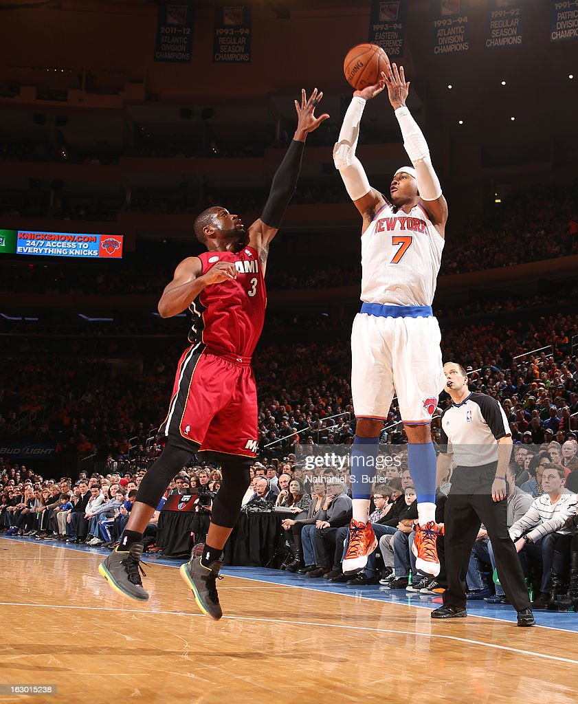 Carmelo Anthony #7 of the New York Knicks shoots against Dwyane Wade #3 of the Miami Heat on March 3, 2013 at Madison Square Garden in New York City.