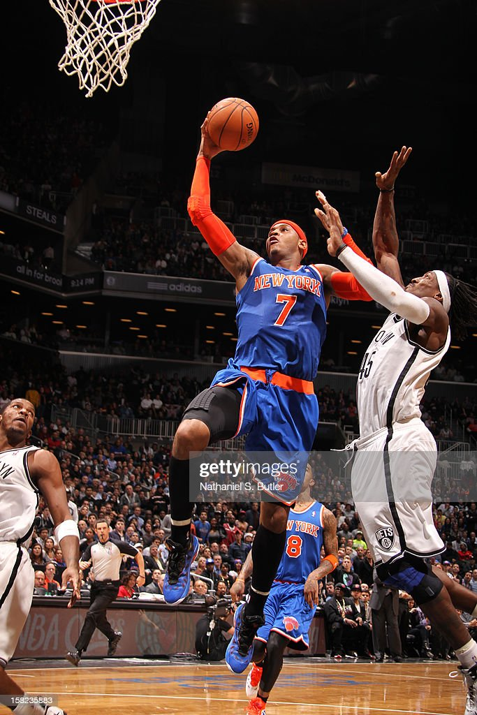 Carmelo Anthony #7 of the New York Knicks shoots against Gerald Wallace #45 of the Brooklyn Nets on December 11, 2012 at the Barclays Center in the Brooklyn borough of New York City.