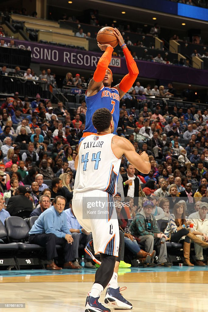 Carmelo Anthony #7 of the New York Knicks shoots against Jeffery Taylor #44 of the Charlotte Bobcats during the game at the Time Warner Cable Arena on November 8, 2013 in Charlotte, North Carolina.