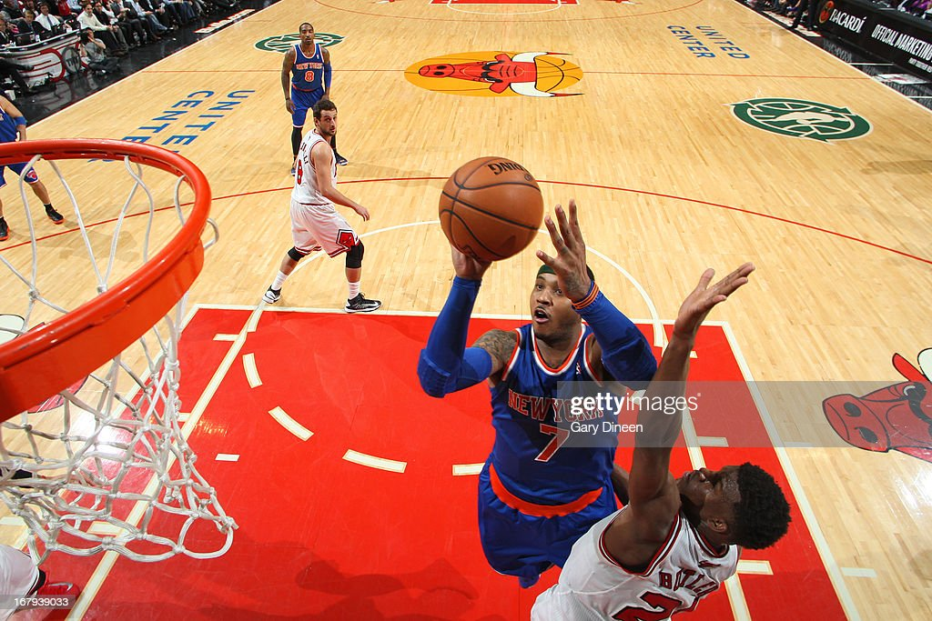 <a gi-track='captionPersonalityLinkClicked' href=/galleries/search?phrase=Carmelo+Anthony&family=editorial&specificpeople=201494 ng-click='$event.stopPropagation()'>Carmelo Anthony</a> #7 of the New York Knicks shoots against <a gi-track='captionPersonalityLinkClicked' href=/galleries/search?phrase=Jimmy+Butler+-+Basketball+Player&family=editorial&specificpeople=9860567 ng-click='$event.stopPropagation()'>Jimmy Butler</a> #21 of the Chicago Bulls on April 11, 2013 at the United Center in Chicago, Illinois.