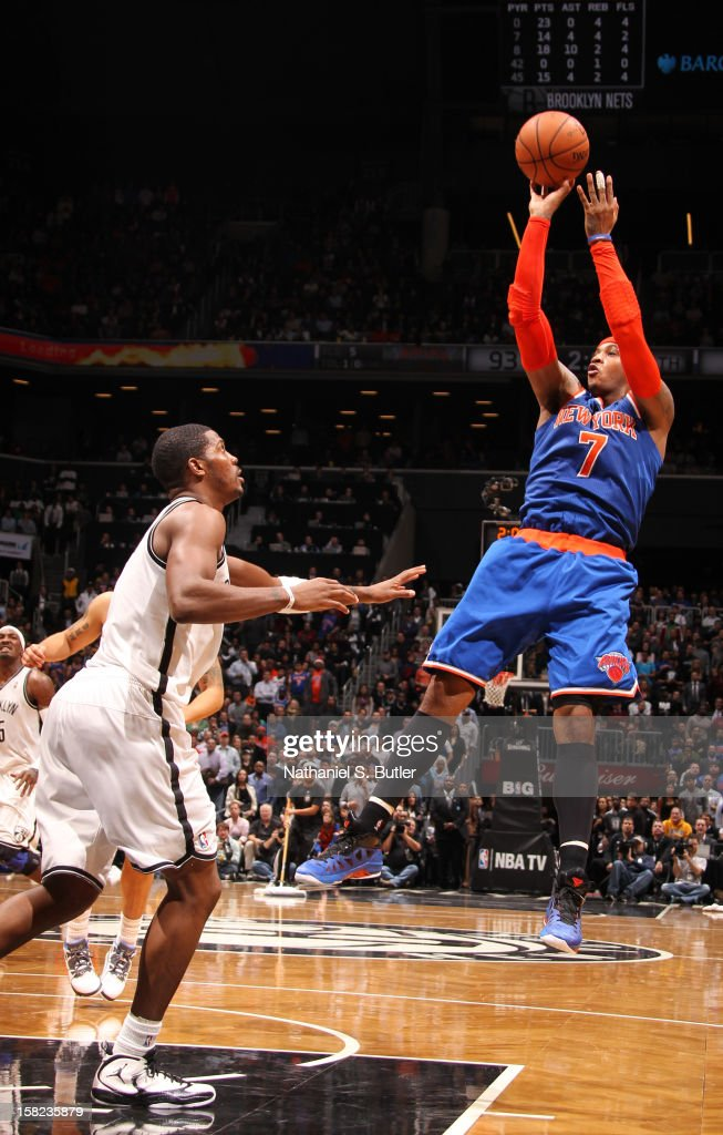 Carmelo Anthony #7 of the New York Knicks shoots against Joe Johnson #7 of the Brooklyn Nets on December 11, 2012 at the Barclays Center in the Brooklyn borough of New York City.