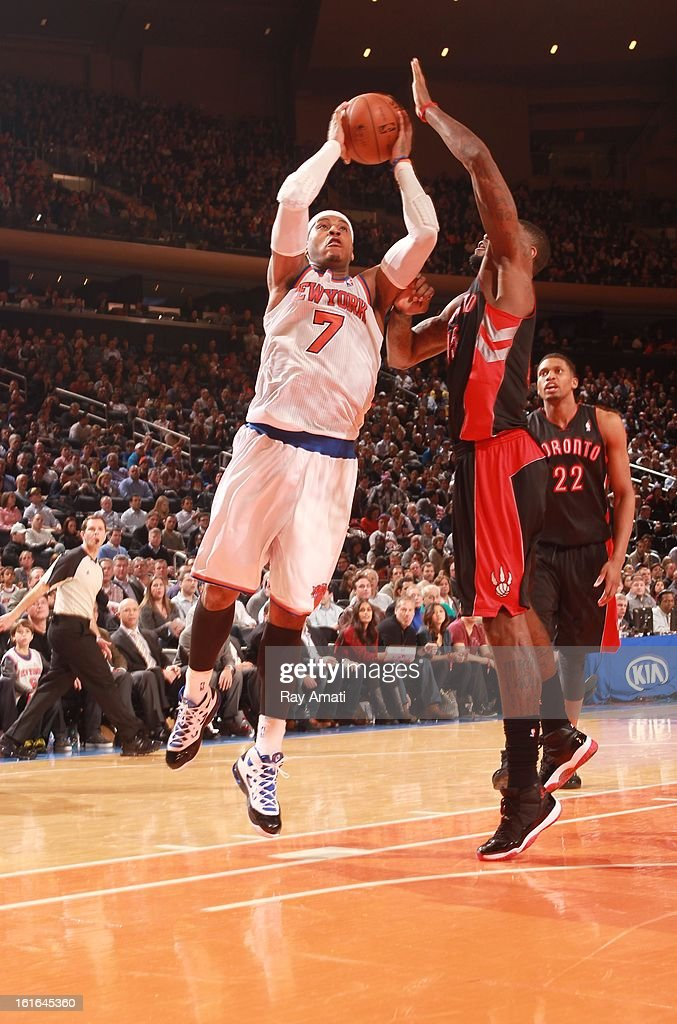 Carmelo Anthony #7 of the New York Knicks shoots against John Lucas III #5 of the Toronto Raptors on February 13, 2013 at Madison Square Garden in New York City.