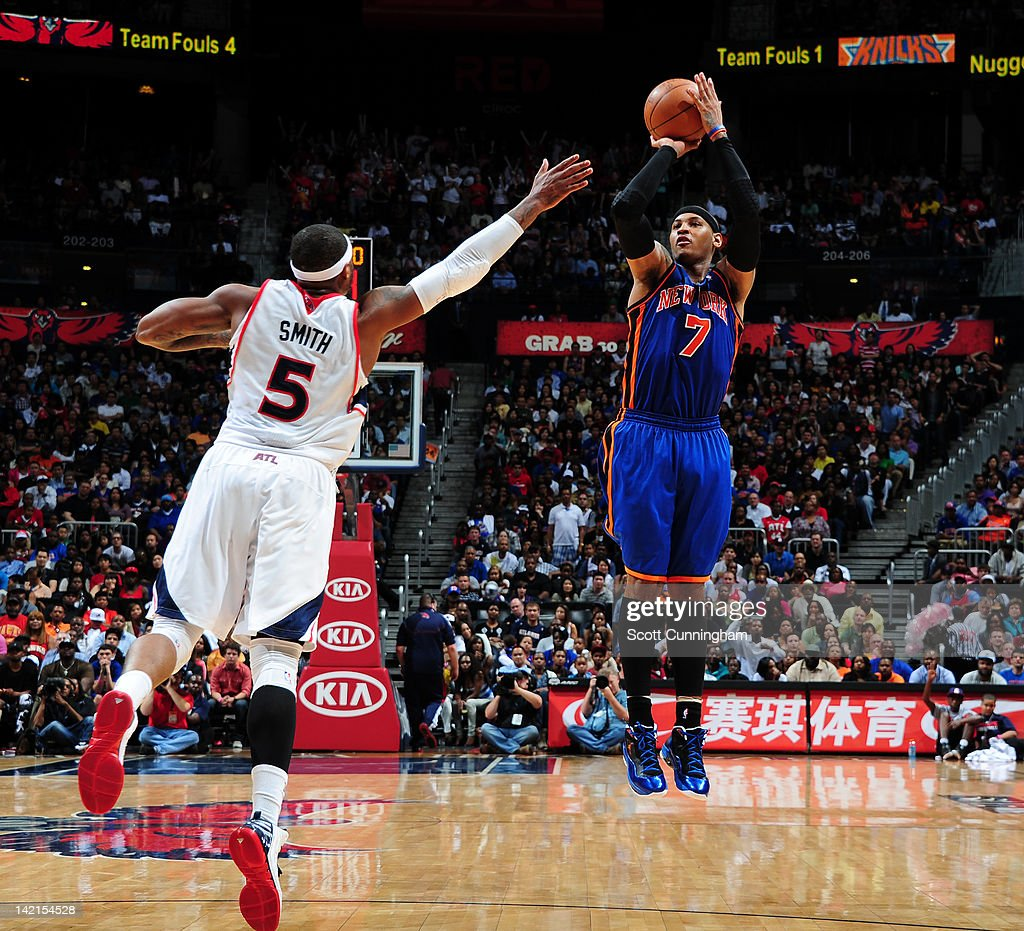 <a gi-track='captionPersonalityLinkClicked' href=/galleries/search?phrase=Carmelo+Anthony&family=editorial&specificpeople=201494 ng-click='$event.stopPropagation()'>Carmelo Anthony</a> #7 of the New York Knicks shoots against <a gi-track='captionPersonalityLinkClicked' href=/galleries/search?phrase=Josh+Smith+-+Basketball+Player+-+Born+1985&family=editorial&specificpeople=201983 ng-click='$event.stopPropagation()'>Josh Smith</a> #5 of the Atlanta Hawks on March 30, 2012 at Philips Arena in Atlanta, Georgia.