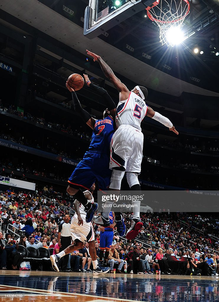 <a gi-track='captionPersonalityLinkClicked' href=/galleries/search?phrase=Carmelo+Anthony&family=editorial&specificpeople=201494 ng-click='$event.stopPropagation()'>Carmelo Anthony</a> #7 of the New York Knicks shoots against <a gi-track='captionPersonalityLinkClicked' href=/galleries/search?phrase=Josh+Smith+-+Basketball+Player+-+Born+1985&family=editorial&specificpeople=201983 ng-click='$event.stopPropagation()'>Josh Smith</a> #5 of the Atlanta Hawks on April 22, 2012 at Philips Arena in Atlanta, Georgia.