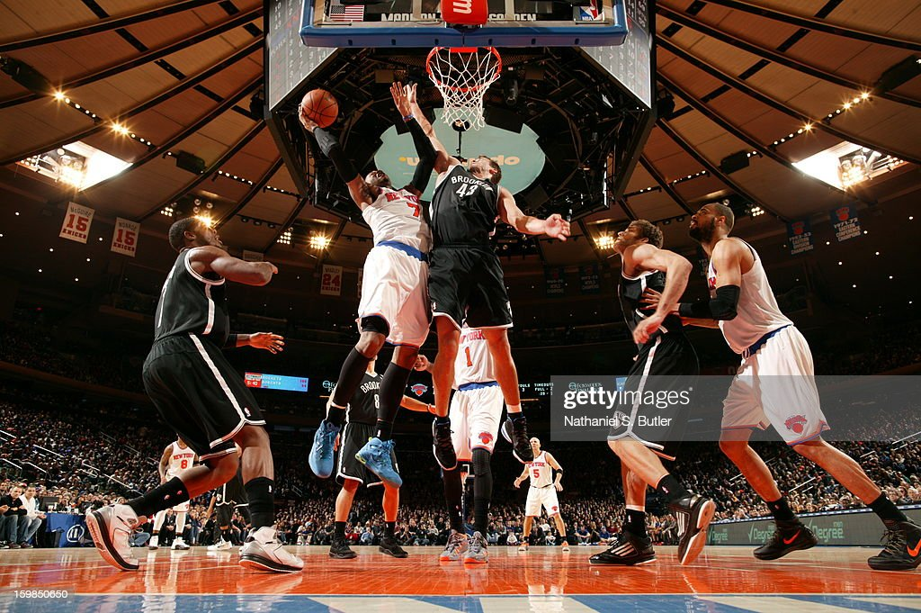 Carmelo Anthony #7 of the New York Knicks shoots against Kris Humphries #43 of the Brooklyn Nets on January 21, 2013 at Madison Square Garden in New York City.