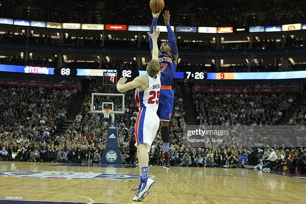 Carmelo Anthony #7 of the New York Knicks shoots against Kyle Singler #25 of the Detroit Pistons during a game between the New York Knicks and the Detroit Pistons at the 02 Arena on January 17, 2013 in London, England.