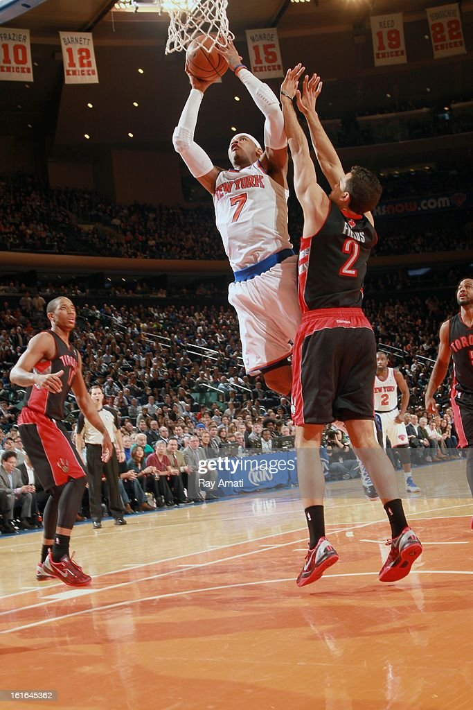 Carmelo Anthony #7 of the New York Knicks shoots against Landry Fields #2 of the Toronto Raptors on February 13, 2013 at Madison Square Garden in New York City.