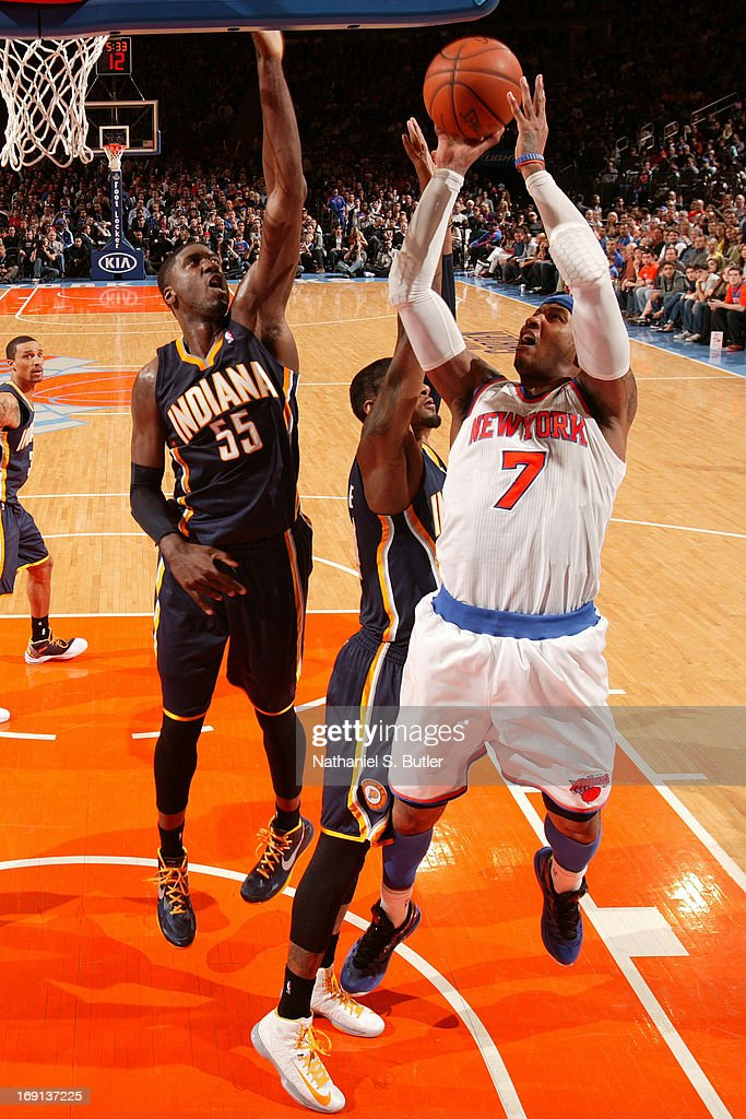 <a gi-track='captionPersonalityLinkClicked' href=/galleries/search?phrase=Carmelo+Anthony&family=editorial&specificpeople=201494 ng-click='$event.stopPropagation()'>Carmelo Anthony</a> #7 of the New York Knicks shoots against Paul George #24 and Roy Hibbert #55 of the Indiana Pacers on April 14, 2013 at Madison Square Garden in New York City.